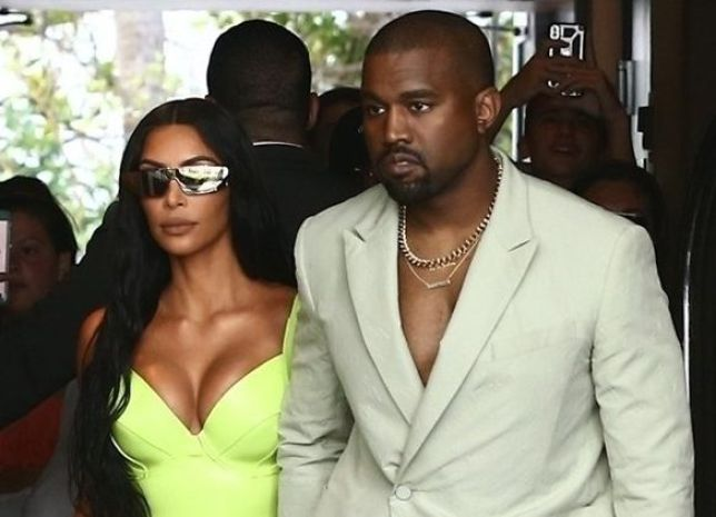 Kanye West attends 2 Chainz's wedding shirtless and wearing