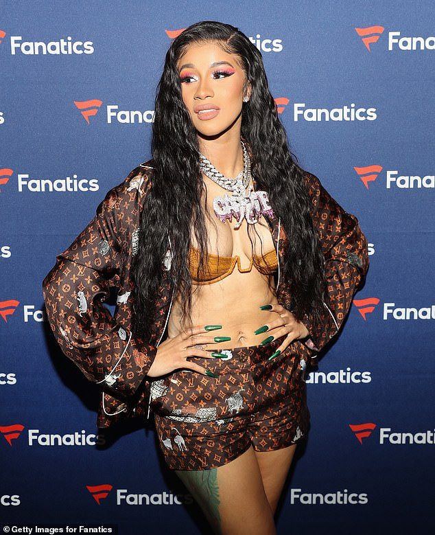 Cardi B Flaunts Her New B Utt Tattoo In Ig Video: Cardi B Flaunts Her Boobs In Skimpy Gold Bra At Fanatics